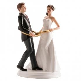 Figura dos noivos com anéis